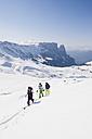 Italy, Trentino-Alto Adige, Alto Adige, Bolzano, Seiser Alm, Group of people on ski tour - MIRF000131