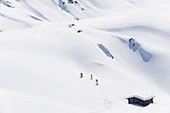 Italy, Trentino-Alto Adige, Alto Adige, Bolzano, Seiser Alm, Group of people on ski tour - MIRF000134