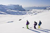 Italy, Trentino-Alto Adige, Alto Adige, Bolzano, Seiser Alm, Group of people skiing on snowy landscape - MIRF000143