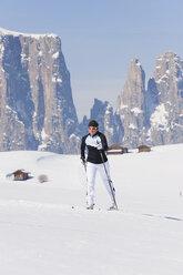 Italy, Trentino-Alto Adige, Alto Adige, Bolzano, Seiser Alm, Mid adult woman doing cross-country skiing - MIRF000158