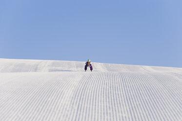 Italy, Trentino-Alto Adige, Alto Adige, Bolzano, Seiser Alm, Mid adult woman skiing on ski slope - MIRF000167