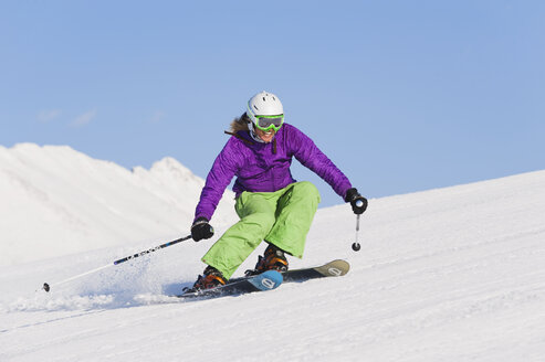 Italy, Trentino-Alto Adige, Alto Adige, Bolzano, Seiser Alm, Young woman skiing - MIRF000188
