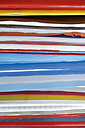 Germany, Stack of colourful school homework note books, close up - TCF001435