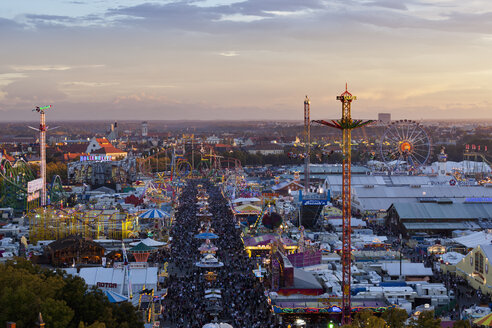 Germany, Bavaria, Munich, View of Oktoberfest fair at dusk - FOF003323