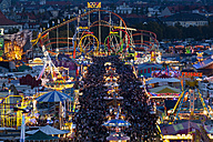 Germany, Bavaria, Munich, View of Oktoberfest fair at night - FO003326