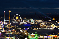 Germany, Bavaria, Munich, View of Oktoberfest fair at night - FO003328