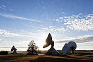 Germany, Bavaria, Raisting, View of antennas at earth station during dusk - FOF003372