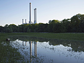 Germany, Munich, View of cogeneration plant with Isar river in foreground - LFF000227