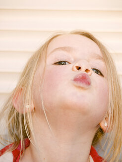 Germany, Bavaria, Close up of girl pouting, portrait - LFF000248
