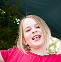 Germany, Bavaria, Close up of girl laughing, portrait - LFF000238