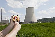 Germany, Bavaria, Unterahrain, Hand of man pressing shut off button near AKW Isar - MAEF003259