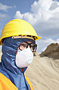 Germany, Bavaria, Man in protective workwear at sand dune - MAEF003319