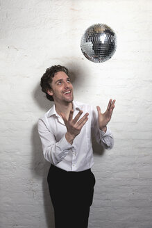 Mid adult man looking at disco ball - DBF000065