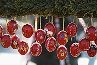 Germany, Bavaria, Franconia, Upper Franconia, Franconian Switzerland, Bieberbach, Easter eggs hanging at easter well, close up - SIEF001459