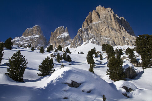 Italy, Dolomites, Langkofel, View of rock and snow in winter - FFF001162