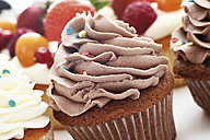 Close up of buttercream chocolate cupcake against white background - CSF014997