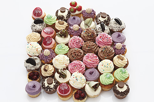 Variety of buttercream cupcakes against white background - CSF014945