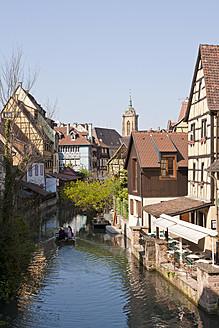 France, Alsace, Colmar, Krutenau, View of La Petite Venise quarter and people in boat at Launch river - WDF000900