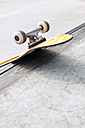 Germany, NRW, Duesseldorf, Skateboard at public skatepark - KJF000109