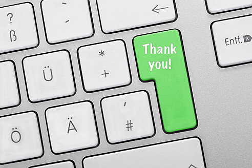 Illustration of keyboard having green key with thank you sign, close up - TSF000304
