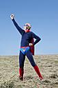Austria, Burgenland, Senior man in superman's costume - MAEF003336