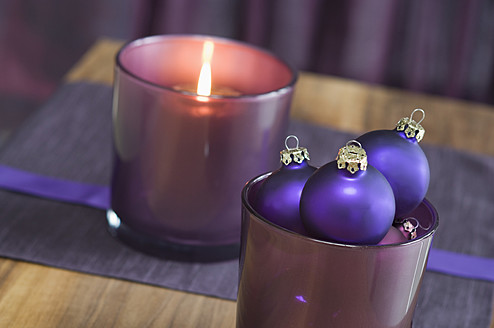 Close up of christmas bauble and tealight candle - ASF004364