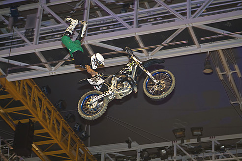 Germany, Munich, Olympia Hall, View of freestyle motocross rider performing stunts - FF001169