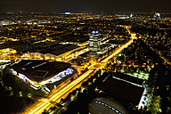 Germany, Bavaria, Munich, View of Olympic Park, BMW Tower, BMW World, BMW Museum and Mittlerer Ring at night - FO003432