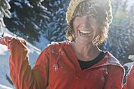 Austria, Salzburg Country, Flachau, Young woman having fun in snow - HHF003699