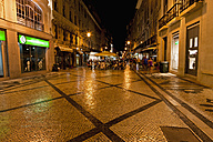 Europe, Portugal, Lisbon, Baixa, View of Rua Augusta road with pedestrian and shopping mile at night - FOF003493
