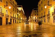Europe, Portugal, Lisbon, Baixa, View of Rua Augusta road with pedestrian and shopping mile at night - FO003500