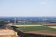 Europe, Germany, North Rhine-Westphalia, Garzweiler, View of lignite mining near wind turbines - CS015328