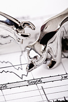 Close up of bear and bull figurine on stock chart - TSF000315