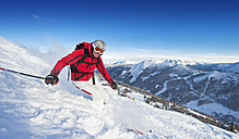 Austria, Salzburg Country, Altenmarkt-Zauchensee, Mid adult man skiing on ski slope in winter - HHF003737