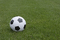 Germany, Icking, Close up of football on grass - TCF001609