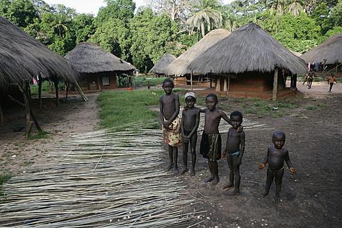 Africa, Guinea-Bissau, Black natives standing in village - DSG000068
