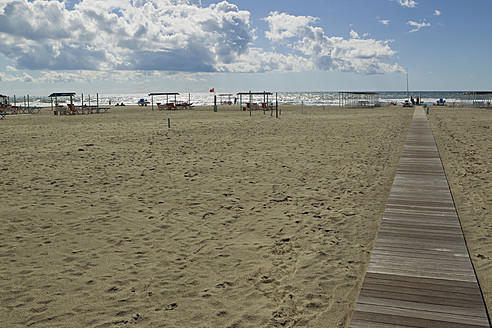 Italy, Forte dei Marmi, View of wooden boardwalk on sandy beach - FFF001208