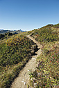 Austria, Kleinwalsertal, View of hiking trail on mountain - MIRF000215