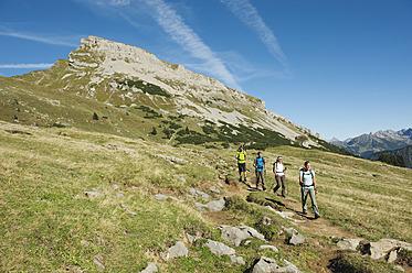 Austria, Kleinwalsertal, Group of people hiking on mountain trail - MIRF000221