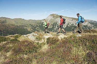 Austria, Kleinwalsertal, Group of people hiking on mountain trail - MIRF000227