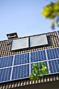 Germany, Cologne,  House rooftops with different of solar panels - TSF000307