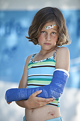 Germany, Bavaria, Wounded girl in swimwear and with broken arm, portrait - MAEF003586