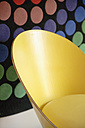 Germany, Upper Bavaria, Munich, Designed chair in new house with multicoloured background - TC001692
