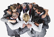 Business people forming huddle against white background - WESTF017011