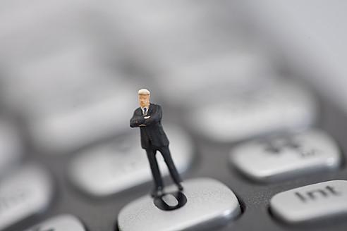 Figurine standing on keyboard - HKF000376
