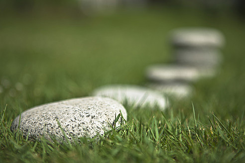 Germany, Braunschweig, Stones in grass, close up - HKF000475