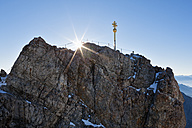 Austria, Germany, Bavaria, Bavarian Alps, View of cross on summit of Zugspitze and wetterstein mountain - FOF003581