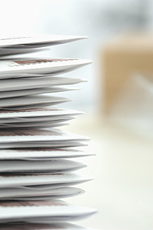Germany, Stack of letters in envelope at office, close up - CRF002100