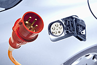 Germany, Power cord with electric car, close up - TSF000358