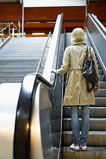 Germany, Bavaria, Munich, Young woman on escalator in metro station - SPOF000011